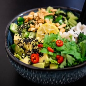 Asian inspired salad with peanuts, lemon and chilli in a blue bowl with black background - Hot for Food All Day