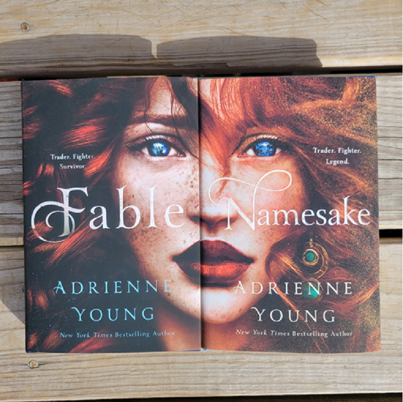 Copies of Fable and Namesake with their covers lined up.