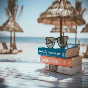 Reading paperback books on a beach vacation""