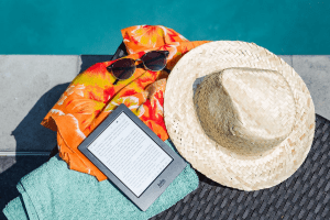 Reading eBooks on a Kobo eReader poolside vacation