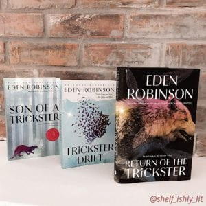 hree books, Son of a Trickster, Trickster Drift and Return of the Trickster by Eden Robinson stand in front of a brick wall