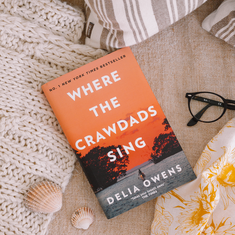 Where the Crawdads Sing Book Sitting on a blanket